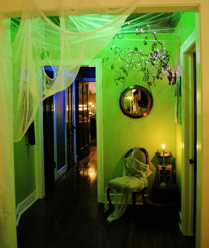 Spooky Green Foyer with Tree Growing Through Wall