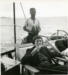 Anne Archbold eating durian on the deck of the Cheng Ho