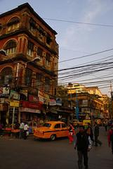 Calcutta Street Scene (peesen) Tags: street india house traffic taxi pedestrian calcutta
