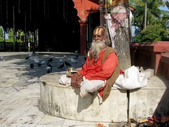 Sadhu (Linda DV (away)) Tags: travel people india canon geotagged temple candles candle prayer blessing shiva assam 2008 siva sevensisters puja sadhu sivasagar sibsagar 7sisters northeastindia powershots5is lindadevolder sivadol