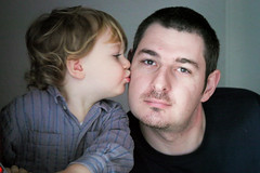Kissing uncle Paupiette (koalie) Tags: christmas portrait kiss cuddle xavier adrien paupiette 20091225christmas