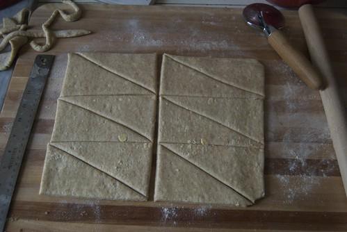 Cutting dough for croissants