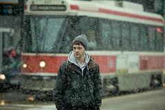 snow walker 2 (tomms) Tags: street winter people snow toronto storm man candid ttc tram explore transit streetcar blizzard frontpage canonef135lf2