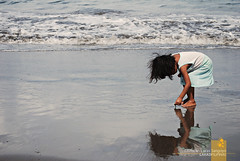 : found it (Lakad Pilipinas) Tags: sea summer sun reflection beach wet water girl up bay kid asia waves afternoon looking philippines shore noon southeast shores bicol picking luzon camarinessur nikond80 camsur sagnay nikkor1855mmvr audioscience sangoyo christianlucassangoyo