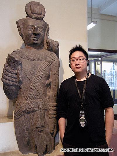 Me beside a random statue