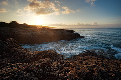 Rocky Sunrise (Philipp Klinger Photography) Tags: morning blue light shadow sea orange cliff cloud sun cold water weather yellow rock clouds sunrise island islands mar spain nikon rocks warm wasser europa europe mediterranean day mare waves ray angle horizon wide rocky wideangle cliffs insel espana foam rays mallorca philipp ultra islas spanien mediterraneansea majorca baleares balearen balearicislands balearic uwa espanya balears weitwinkel klinger illesbalears inseln mittelmeer malle ultrawideangle islasbaleares illes dawm balearischeinseln d700 balearische