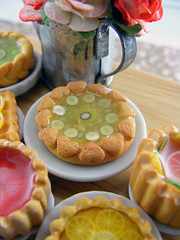 Kiwi-Banana Pie (Shay Aaron) Tags: flowers party food house scale kitchen rose fruit pie crust table dessert miniature lemon doll counter handmade aaron fake mini polymerclay fimo bakery tiny pastry faux shay grapefruit resin jello tart 12th 112 wateringcan dollhouse petit  twelfth tartlet        shayaaron