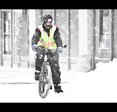 39 / 365: Snow Day (Chris Hlady) Tags: winter snow storm ice dof wind streetphotography blizzard blowingsnow bikeriding safetyvest