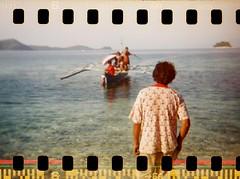 Waiting (doycataluna) Tags: film beach analog 35mm island boat holga lomo lomography fuji philippines coron holga120 palawan sprockets islandlife busuanga holga135 coronpalawan