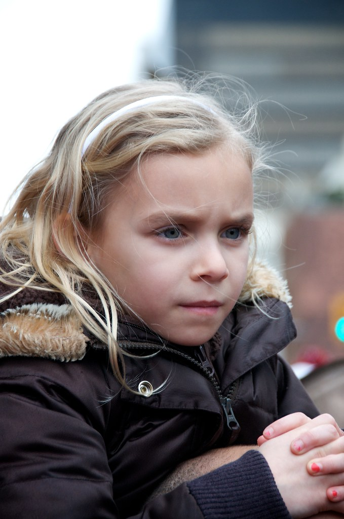 Young Girl Watches the Torch Relay