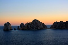 The end to a great day in Cabo.. (David Fitzgerald3) Tags: ocean travel cruise carnival blue light sunset sea vacation sky cliff sun seascape beach nature water sunshine clouds skyscape landscape mexico island coast boat canal haze cabo scenery rocks aqua skies sailing ship arch pacific silhouettes mexican cannon layers rays traveling elation cabosanlucas seaofcortez loscabos mywinners davidfitzgerald skytheme cannoneosrebelxs