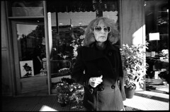 ATHENS OUT (Kiriakos Korakis (korax67)) Tags: street old city bw woman sunglasses standing square photography europe athens greece ilfordxp2 flowershop 21mm contaxg2 biogon ilfordxp2400super autaut biogon2821 plateiaamerikis  kiriakoskorakis kyriakoskorakis