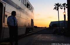 Gazing Westward (El Roco Photography) Tags: california railroad sunset santafe station night train canon diesel rail trains socal amtrak transportation locomotive orangecounty ge fullerton glint railroads pacificsurfliner passengertrain emd superliner atsf burlingtonnorthernsantafe fullertoncalifornia f59phi alltrains amtrakcalifornia bnsfrailroad burlingtonnorthernsantaferailroad elrocophotography