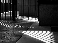 urban abstract (donvucl) Tags: street light bw london grate shadows textures comp sunbeams donvucl olympusepl5