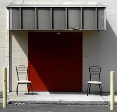 employee lounge #8 (Wing Collar) Tags: chairs awning reddoor cinderblock