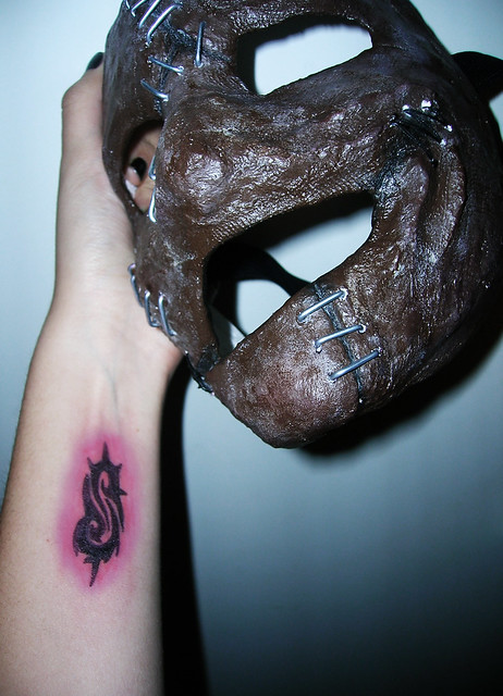 My arm with my future Slipknot tattoo and my mask of Corey Taylor from the