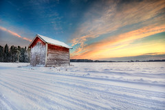 Snowy Sunset (Mikko Lagerstedt) Tags: road blue trees light sunset shadow red sky snow color green art nature colors beautiful field clouds photoshop suomi finland landscape photography photo cabin nikon colorful view graphic natural image photos unique fineart stock fine shed perspective award sigma finnish 1020mm sell 2009 hdr mikko resize latyrx d90 nikond90 mikkolagerstedt lagerstedt