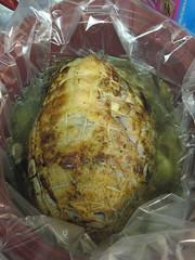 Browned pork shoulder in apple juice/water/garlic mixture for cooking