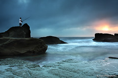 Fisherman @ Forresters Beach (-yury-) Tags: ocean sea sky cloud seascape beach water sunrise canon landscape coast fisherman rocks waves central australia nsw 5d forresters supershot abigfave karmapotd karmapotw