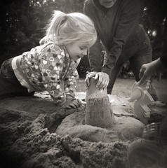 her first sandbox (manyfires) Tags: summer portrait film girl toys holga sand toddler toycamera iowa alaina sandcastle sandbox madefromatractortireofcourse