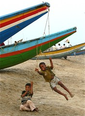 Fun at Fishing Village, Puri, Orissa (Sekitar) Tags: india beach kids children fun boat fishing village play orissa puri sekitar earthasia sekitar