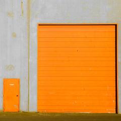 April 22, 2010 (Doug Murray (borderfilms)) Tags: door orange washington big pod doors garage small warehouse bellingham wa sizes likefatherlikeson 2010 photooftheday april22 wanderismcom roadspillorg borderfilmscom