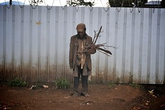 alone (Dave Schreier) Tags: poverty new wood man thanks fire sadness guinea justice alone sad god homeless jesus social dirty clothes dirt barefoot thankful papua barbwire firewood shoeless saddnes