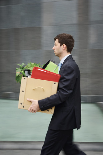 a man walking with a box full of material