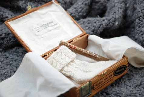 baby socks in cigar box