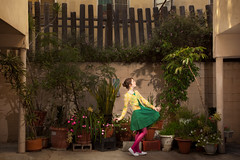Lauren Randolph (laurenlemon) Tags: flowers selfportrait green me girl fence garden march dance apartment garage creative dressup pottedplants conceptual 2010 canoneos5dmarkii laurenrandolph laurenlemon wwwphotolaurencom