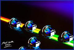 Full Spectrum (MarkLandonPhotography) Tags: colour macro water closeup canon droplets dvd rainbow spectrum vibrant vivid sparkle windowlight 250d ef100mmf28usmmacro refration 40d lr2 marklandonphotography