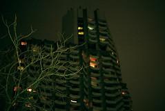 Batmans loft (__MV__) Tags: city windows urban tree film night analog skyscraper canon 50mm darkness nacht scan stadt f18 18 om2 mannheim hochhaus collini 8800f