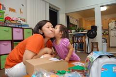 Aki giving mama a kiss