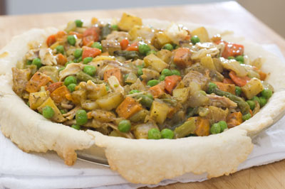 pie bottom filled with vegetable and chicken mixture
