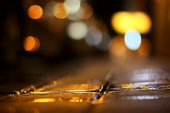 a vision softly creeping:  316/365 (helen sotiriadis) Tags: street wet night canon published dof bokeh pavement athens depthoffield greece sidewalk tiles 365 canonef50mmf14usm  canoneos40d toomanytribbles dslrmag