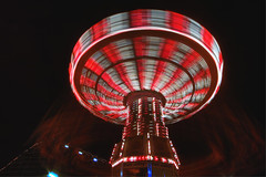 you spin me round and round (Eyesplash - There is a change in the air.) Tags: park longexposure night lights ride swings swing rollercoaster amusment pacificnationalexhibition waveswinger