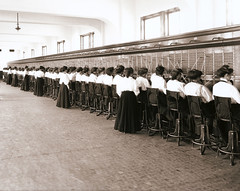 "Telephone Switchboard Operators - a vintage circa 1914 photo (cropped) (IronRodArt - Royce Bair (""Star Shooter"")) Tags: old people woman history female work vintage cord person team support women call phone panel tech antique telephone union working young cable center headset retro professional communication number business listening help operators plug customer service worker network cheerful talking job helpful operator assistance communications oldfashioned receptionist occupation switchboard callcenter businesswoman cordboards"
