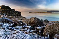 Blue ice, sea and sky. (gst Eir) Tags: blue sunset sea sky mountains ice nature colors beautiful rock clouds iceland shoreline reykjavik distillery steinar grafarvogur akrafjall s viey kartpostal grjt concordians flickrunitedaward