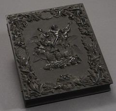 """Lincoln Portrait Photograph in Molded Thermoplastic """"Vision of Ezechiel"""" Case (Cornell University Library) Tags: animals portraits visions wings politics angels tables inkwells ezekiel prophecy floralpatterns tophats godthefather lincolnabraham cornelluniversitylibrary culidentifier:lunafield=idnumber casescontainers culidentifier:value=2214bb0125"""