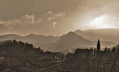 Small villages and old volcanoes - Paesini e vecchi vulcani (Robyn Hooz) Tags: italy panorama sun church sepia clouds canon landscape is italia nuvole village hills chiesa soil rough volcanoes sole efs padova colli teolo euganei vulcani 55250 1000d saariysqualitypictures