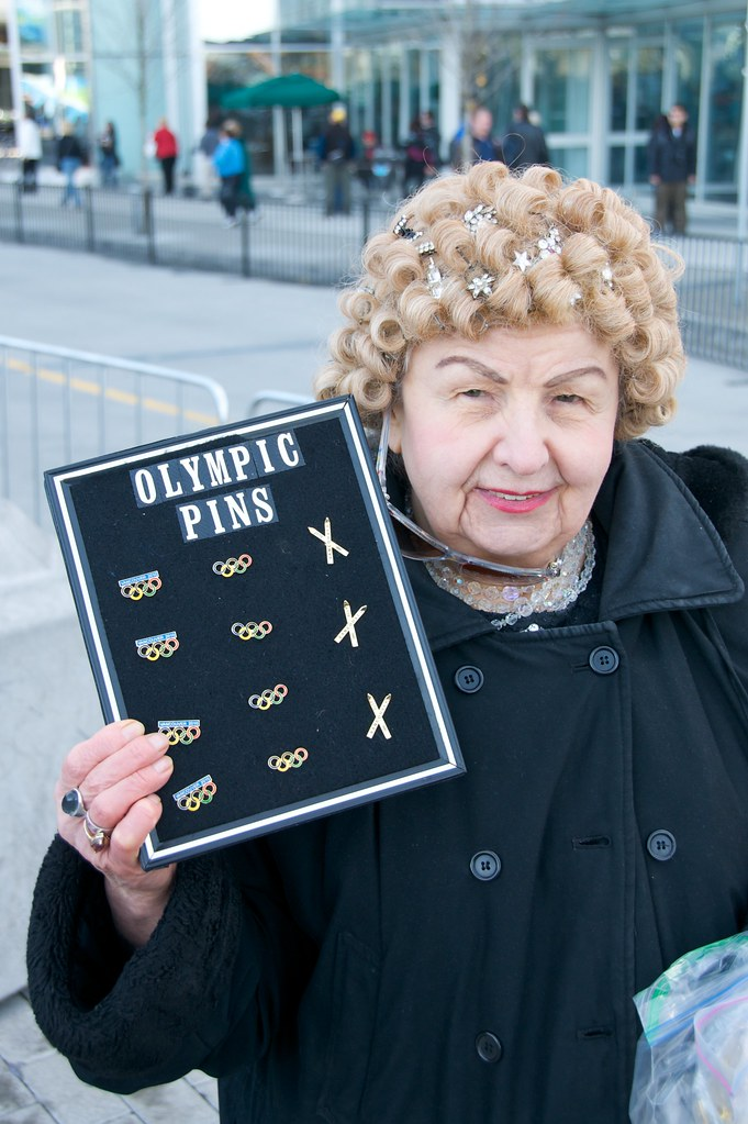 Friendly Old Lady Sells Pins Has Heart of Gold