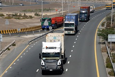 TRUCKING IN DUBAI (Claude  BARUTEL) Tags: dubai united transport emirates arab sharjah trucking scania