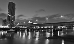 A city still, reflecting (K. J. Reilly) Tags: bridge white black reflection building night canon river eos lights mono belfast 1100d
