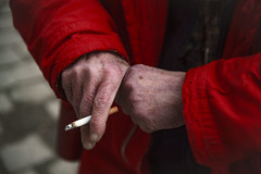 portrait of a smoker (adrian raymer) Tags: red coat grandpa grandfather old man smoking cigarettes addiction stubborn portuguese outside soft depth field worn out hands dirty nails cold wrinkly sad blue tone canon fd 50mm 14 markii 5d adrian raymer photography