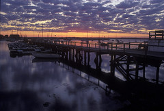 Sakonnet Harbor RI, at Sunset ( Pacheco) Tags: ocean longexposure light sunset cloud seascape docks boats skies purple newengland velvia eastcoast pacheco massachusettes purplesky oceanlandscape sakonnetharbor