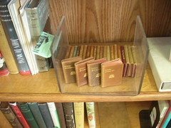 If you need something unique, look no further than our glass cases. They hold  collectible books, like these vintage miniature Shakespeare plays.