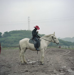 cow boy  (wang yuanling) Tags: china red horse rolleiflex river cowboy kodak smoking yangtzeriver chongqing threegorges rolleiflex28f subjective  pro160