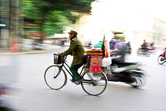 Bike rider 1 (imagesbyjillian) Tags: road street people blur color colour hat bike bicycle night balloons movement asia traditional vietnam motorbike colourful hanoi traffice conical oldquarter