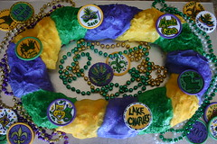Traditional King Cake (The Cake Batter) Tags: new party baby lake color green me fleur cake night de rouge gold la beads orleans louisiana king purple mask cinnamon fat traditional jazz charles parade ring tuesday icing mister gras tri something mardi mascarade baton throw lis filling 2010 lent mamou twelth doubloons