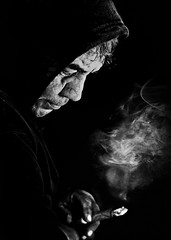 Smoking (Alfredo11) Tags: bw man thoughtful bn smoking pensativo lowkey hombre meditative fumando emociones nikoncreativelightingsystem nikond300 exotions